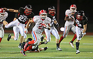 Washington's Joseph McBride (21) runs back a kick during the first quarter of the game between Cedar Rapids Washington and Linn-Mar at Linn-Mar Stadium in Marion on Friday, September 14, 2012.
