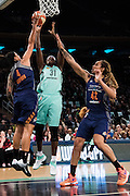 Tina Charles #31 of the New York Liberty drives to the basket against Candice Dupree #4 and Brittney Griner #42 of the Phoenix Mercury during the second round of the WNBA Playoffs at Madison Square Garden in New York on September 24, 2016. (Cooper Neill for The New York Times)
