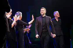 "© Licensed to London News Pictures . 12/01/2016 . Salford , UK . Writers GARY BARLOW (c) and TIM FIRTH (r) make a surprise appearance and Barlow performs in front of the audience at the Lowry Theatre ,  during the opening week of "" The Girls "" , a musical they wrote based on the story "" Calendar Girls "" , about a group of Women's Institute members in Yorkshire , who made a nude calendar . Photo credit : Joel Goodman/LNP"