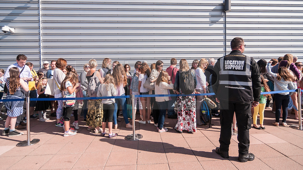 "© Licensed to London News Pictures. 18/07/2015. London, UK. Thousands of girls, aged between eight and 12, converge on ExCel London to attend Warner Brothers' open casting for the role of ""Modesty"" in the forthcoming Harry Potter spin-off, Fantastic Beasts and Where to Find Them.  The studio is searching for a ""haunted young girl with an inner strength and stillness"".  Whoever is selected will play alongside a star studded cast, including Eddie Redmayne, and with a screenplay written by Harry Potter author, JK Rowling. Photo credit : Stephen Chung/LNP"