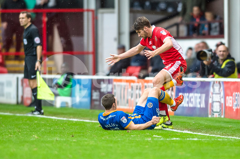 Shaun Whalley of Shrewsbury Town slides in on Luke Leahy of Walsall during the EFL Sky Bet League 1 match between Walsall and Shrewsbury Town at the Banks's Stadium, Walsall, England on 7 October 2017. Photo by Darren Musgrove.