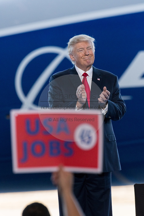 U.S. President Donald Trump smiles as he waits to address employees at the debut of the new Boeing 787-10 Dreamliner aircraft at the Boeing factory February 17, 2016 in North Charleston, SC. The visit comes two days after workers at the South Carolina plant voted to reject union representation in a state where Trump won handily.