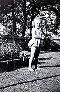 one little girl posing for a picture in the garden France vintage