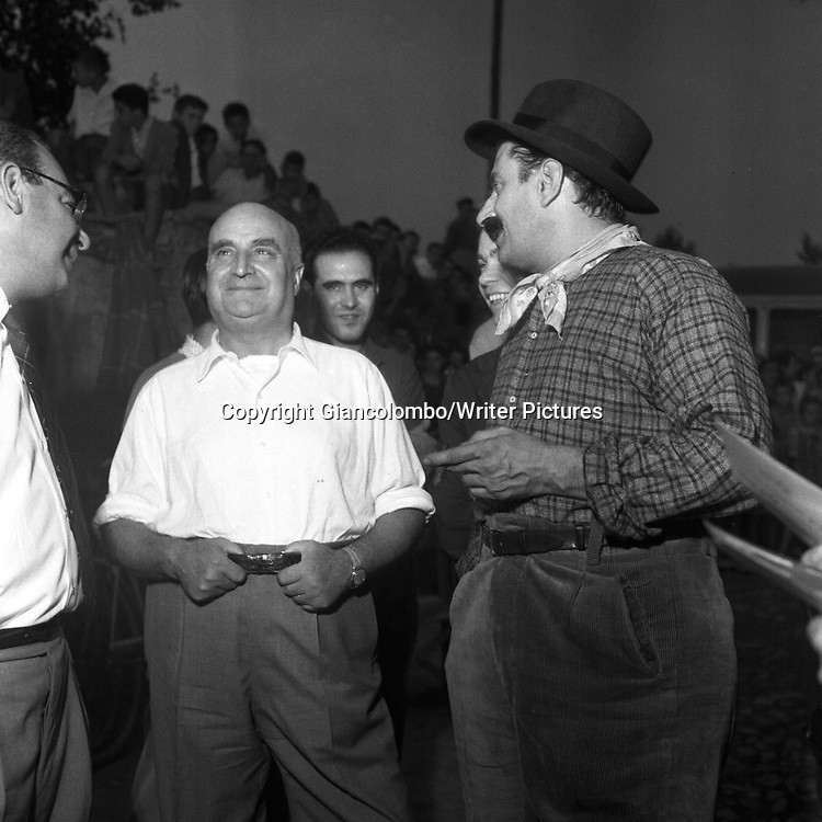 Giovannino Guareschi with producer Angelo Rizzoli , on the set of the movie The Little World of Don Camillo, made out of his novel. Brescello, (Parma)<br /> 1951<br /> <br /> Photograph by Giancolombo/Writer Pictures<br /> <br /> WORLD RIGHTS, NO AGENCY, NO ITALY