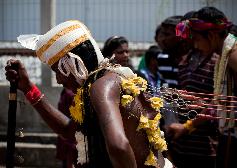 Hooks are used to attach heavy objects to the pilgrims body before the ascent to the caves. Thaipusam Festival, Batu Caves, Malaysia. It is a Hindu festival celebrated mostly by the Tamil community on the full moon in the Tamil month of Thai (Jan/Feb). The festival celebrates the birth of Murugan,the youngest son of Shiva and his wife Parvati. The festival at Batu Caves, Kuala Lumpur culminates in a 272 step climb into the cave.