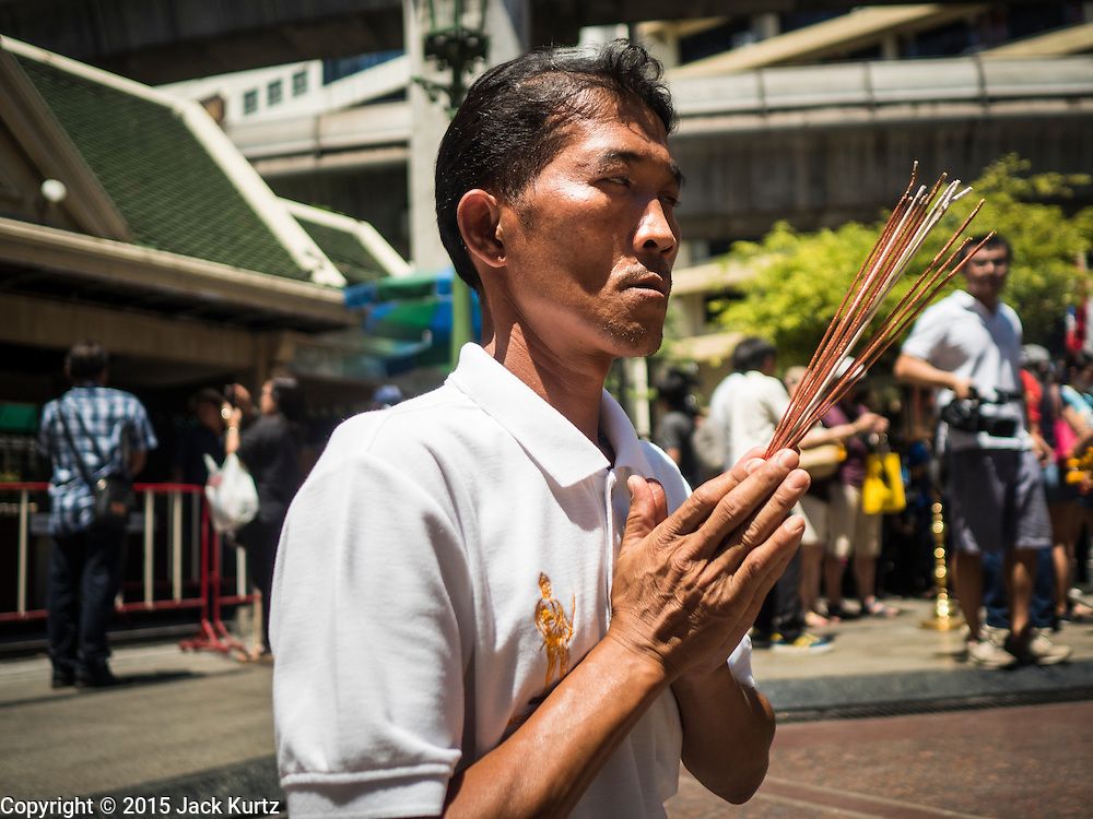 19 AUGUST 2015 - BANGKOK, THAILAND:  A Thai man who lost members of his family in the terror bombing at Erawan Shrine prays at the shrine before a memorial service for his family. Erawan Shrine in Bangkok reopened Wednesday morning after more than 20 people were killed and more than 100 injured in a bombing at the shrine Monday, August 17, 2015. The shrine is a popular tourist attraction in the center of Bangkok's high end shopping district and is an important religious site for Thais. No one has claimed responsibility for the bombing.      PHOTO BY JACK KURTZ