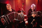 Sexteto Mayor, one of the best tango orchestras in the world, play at Club Huracan.<br /> <br /> Pepe Libertella, the founder of Sexteto Mayor, died recently.<br /> <br /> Between 1865 and 1914 the population of Buenos Aires swelled from 150.000 to 1.5 million. The bulk of this contingent was made up of immigrants from Europe, Italy in particular. At the beginning of the 20th century, in the slums and in the red light districts, there occurred a fusion of all the musical traditions of immigrants, natives, original Spanish settlers and Black slaves. Something completely new was born &ndash;the tango. Blacks brought the syncopated rhythms and the proximity of the bodies, Jewish settlers added the violin, German immigrants the bandoneon, Italians the haunting melodies of Sicily, and Spanish, the sometimes joyful, sometimes mournful intensity of the Andalucian tango, a form of canto flamenco.