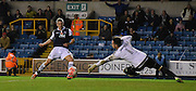 Steve Morrison beats Matt Urwin for Millwall's third during the The FA Cup match between Millwall and Flyde at The Den, London, England on 7 November 2015. Photo by Michael Hulf.