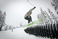 JEROME A. POLLOS/Press..A skier lands on top of a corrugated tube in the terrain park at Lookout Pass Ski Area during opening day for the mountain on the Idaho-Montana state line. The Nov. 13 opening is the earliest since 2003 when Lookout opened started its chair lift Nov. 6.