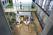 A British Airways employee makes a call in atrium at company corporate headquarters at Waterside at Harmondsworth..