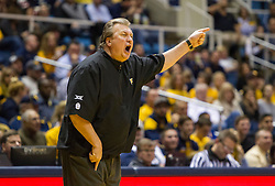 Jan 26, 2016; Morgantown, WV, USA; West Virginia Mountaineers head coach Bob Huggins yells at an official after being assessed a technical foul during the first half against the Kansas State Wildcats at the WVU Coliseum. Mandatory Credit: Ben Queen-USA TODAY Sports