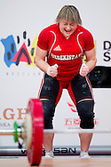 Marina Sisoeva from Uzbekistan lifts in Snatch competition women's 53 kg Group B during weightlifting IWF World Championships Wroclaw 2013 at Centennial Hall in Wroclaw on October 21, 2013.<br /> <br /> Poland, Wroclaw, October 21, 2013<br /> <br /> Picture also available in RAW (NEF) or TIFF format on special request.<br /> <br /> For editorial use only. Any commercial or promotional use requires permission.<br /> <br /> Mandatory credit:<br /> Photo by © Adam Nurkiewicz / Mediasport