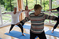 Seniors Yoga class at Debbie Hodgson's yoga studio in Blackheath yoga practitioner Susan Tomnay during class with other ladies Sue Olsen, Sally Brezzo.