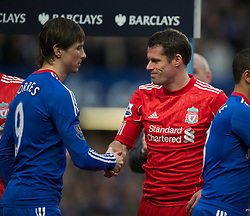 LONDON, ENGLAND - Sunday, February 6, 2011: Liverpool's Jamie Carragher shakes hands with Chelsea's Fernando Torres before the Premiership match at Stamford Bridge. (Photo by David Rawcliffe/Propaganda)