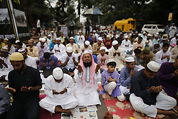 June 16, 2018 - Dhaka, Bangladesh - Dhaka, Bangladesh. Bangladeshi Muslim devotees take part in Eid-ul-Fitr prayer on a road near National Eidgah premises in Dhaka, Bangladesh on June 16, 2018. Muslims around the world celebrate Eid-ul-Fitr festival with their families and friends at the end of the holy fasting month of Ramadan. (Credit Image: © Rehman Asad/NurPhoto via ZUMA Press)