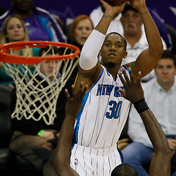 Mar 22, 2010; New Orleans, LA, USA; New Orleans Hornets forward David West (30) shoots over Dallas Mavericks center Brendan Haywood (33) during the second half at the New Orleans Arena. Mandatory Credit: Derick E. Hingle-US PRESSWIRE