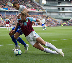 Lee Peltier of Cardiff City (L) is judged to have fouled Charlie Taylor of Burnley - Mandatory by-line: Jack Phillips/JMP - 13/04/2019 - FOOTBALL - Turf Moor - Burnley, England - Burnley v Cardiff City - English Premier League