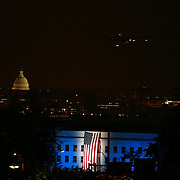 Arlington, Va., Sept. 11, 2008 - A Flag draped over the Pentagon is illuminated on Thursday, Sept. 11, 2008 in Arlington, Va.