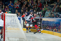 KELOWNA, CANADA - NOVEMBER 1:  Cole Ully #21 of the Kamloops Blazers checks Henrik Nyberg #21 of the Kelowna Rockets into the boards as the Kamloops Blazers visit the Kelowna Rockets on November 1, 2012 at Prospera Place in Kelowna, British Columbia, Canada (Photo by Marissa Baecker/Shoot the Breeze) *** Local Caption ***
