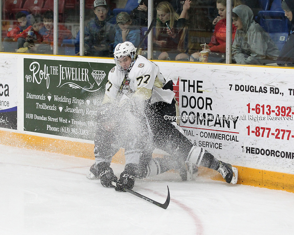 TRENTON, ON  - DEC 1,  2017: Ontario Junior Hockey League game between the Trenton Golden Hawks and the Cobourg Cougars. Shawn Guison #77 of the Trenton Golden Hawks makes the hit on Connor MacEachern #9 of the Cobourg Cougars during the second period.<br /> (Photo by Tim Bates / OJHL Images)