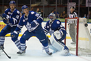 Marlies goaltender Jonathan Bernier, far right, stops a puck with help from teammates Richard Panik, left, and Stuart Percy, center, during a game against the Rochester Americans in Rochester, New York, USA on Friday, December 4, 2015.