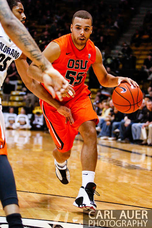 January 2nd, 2014:  Oregon State Beavers senior guard Roberto Nelson (55) drives the ball towards the basket in the first half of the NCAA Basketball game between the Oregon State Beavers and the University of Colorado Buffaloes at the Coors Events Center in Boulder, Colorado