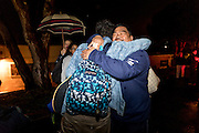 Mr. Tacata gets a hug from students as they head home.