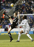 Photo: Aidan Ellis.<br /> Bolton Wanderers v Fulham. The Barclays Premiership. 11/02/2007.<br /> Fulham's Heidar Helguson clears the ball from Bolton's Ricardo Gardener