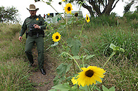 Leonel Guerrero, a Senior Patrol Agent with the U.S. Border Patrol, on duty near the Gateway Bridge that crosses the Rio Grande, the river marks the border between the U.S. and Mexico in Texas, in Brownsville, TX on April 21, 2010. (Photo/Scott Dalton)