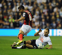 Derby County's John Eustace tackles Bournemouth's Andrew Surman - Photo mandatory by-line: Dougie Allward/JMP - Mobile: 07966 386802 - 30/09/2014 - SPORT - Football - Derby - Pride Park - Derby County v AFC Bournemouth - Sky Bet Championship