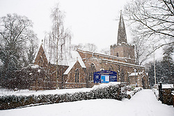 St Deny's Church in snow, Evington Village, Leicester, Leicestershire, England, UK.