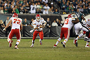 Kansas City Chiefs quarterback Alex Smith (11) runs the ball through a hole in the line created by blocks by Kansas City Chiefs offensive tackle Eric Fisher (72) and Kansas City Chiefs guard Jon Asamoah (73) during the NFL week 3 football game against the Philadelphia Eagles on Thursday, Sept. 19, 2013 in Philadelphia. The Chiefs won the game 26-16. ©Paul Anthony Spinelli