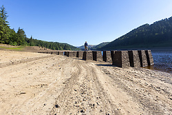 July 5, 2018 - Upper Derwent Valley, Derbyshire, UK - Upper Derwent Valley UK. Scenes this morning at Derwent Reservoir in Derbyshire show the extent the water level has dropped during the UK heatwave leaving a old construction railway bridge visible on the shoreline. (Credit Image: © Andrew Mccaren/London News Pictures via ZUMA Wire)
