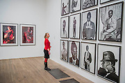 Works by Cindy Sherman, Untitled (L), and Samual Fosso, African Spirits - Tate Modern's new photography show, Performing for the Camera. The exhibition examines the relationship between photography and performance, from the invention of photography in the 19th century to the selfie culture of today, bringing together over 500 images spanning 150 years. Highlights include: artist Romain Mader and his series Ekaterina, which follows Romain's fictitious search for a bride in Eastern Europe; Amalia Ulman's social media sensation Excellences and Perfections performed over a four month period on Instagram; and a wall of artist-designed advertising posters by the likes of Jeff Koons, Andy Warhol and Joseph Beuys. Performing for the Camera is at Tate Modern from 18 February – 12 June 2016.