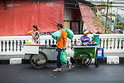 06 JUNE 2013 - BANGKOK, THAILAND:    Fruit vendors in front of Bobae Market on Krung Kasem Rd in Bangkok. Bobae Market is a 30 year old market famous for fashion wholesale and is now very popular with exporters from around the world. Bobae Tower is next to the market and  advertises itself as having 1,300 stalls under one roof and claims to be the largest garment wholesale center in Thailand.       PHOTO BY JACK KURTZ