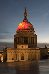 "© Licensed to London News Pictures. 01/09/2016. London, UK. A projection of flames onto the dome of St Paul's Cathedral called ""Fires Ancient"" by Martin Firrell echoes the fire that gave birth to the iconic Wren building that emerged, phoenix-like, from the ashes.  The projection is part of Great Fire 350, a commemoration of the 350th anniversary of the Great Fire of London, taking place in the capital 1 to 4 September. Photo credit : Stephen Chung/LNP"