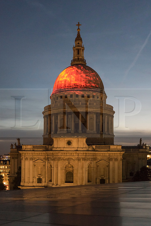 """© Licensed to London News Pictures. 01/09/2016. London, UK. A projection of flames onto the dome of St Paul's Cathedral called """"Fires Ancient"""" by Martin Firrell echoes the fire that gave birth to the iconic Wren building that emerged, phoenix-like, from the ashes.  The projection is part of Great Fire 350, a commemoration of the 350th anniversary of the Great Fire of London, taking place in the capital 1 to 4 September. Photo credit : Stephen Chung/LNP"""