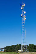 Rural cellular, microwave and communications antenna array for the mobile telephone system on a triangular lattice tower and equipment enclosure shelter in country Victoria, Australia.
