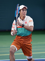 March 8, 2019 - Indian Wells, CA, U.S. - INDIAN WELLS, CA - MARCH 08: Kei Nishikori (JPN) in action in the first set of a doubles match during the BNP Paribas Open played at the Indian Wells Tennis Garden in Indian Wells, CA. (Photo by John Cordes/Icon Sportswire) (Credit Image: © John Cordes/Icon SMI via ZUMA Press)