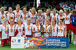 30-06-2012 LACROSSE: EUROPEES KAMPIOENSCHAP ENGELAND - WALES: AMSTERDAM<br /> (L-R) Team England with gold medals and trophy, a.o. 3 Leah Templeman, 27 Laura Merrifield, 5 Ruby Smith, 5 Ruby Smith, 33 Laura Plant, 2 captain Katy Bennett, 40 Emily Gray, 25 Lucy Lynch, 17 Olivia Wimpenny, 12 Sophie Brett, 34 Alex Bruce ENG. England wins the gold medal match against Wales<br /> ©2012-FotoHoogendoorn.nl / Peter Schalk