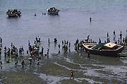 Fishermen arriving at the beach that serves as Ilha de Mozambique fishing harbour
