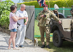 © Licensed to London News Pictures. 05/06/2014.  Local re enactment groups head out onto Pegasus Bridge this afternoon ahead of the 70th Anniversary of the D Day landings in Normandy.  Photo credit : Alison Baskerville/LNP