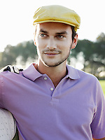 Young male golfer on course portrait