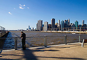 Lonely man by the water at the end of Atlantic Avenue in Brooklyn.