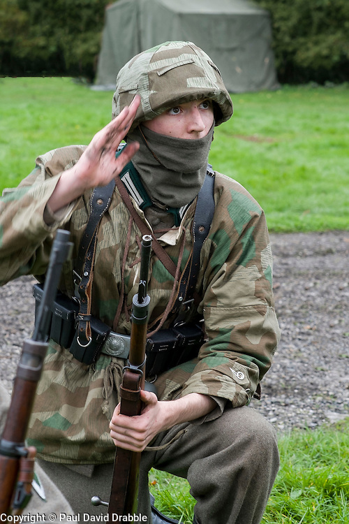 A Re-enactor portrayiing a German panzer grenadier from the Grossdeutschland Division during a battle battle re-enactment in on Pickering Showground<br /> <br /> 17/18 October 2015<br />  Image &copy; Paul David Drabble <br />  www.pauldaviddrabble.co.uk