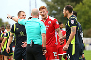 Referee Kevin Johnson  sends off Crawley's Josh Yorwerth  during the Sky Bet League 2 match between Crawley Town and Carlisle United at the Checkatrade Stadium in Crawley. 30 Sep 2017