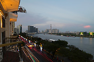 A constant stream of traffic outside the Majestic Hotel along the Saigon River Ho Chi MInh City, Vietnam, Southeast Asia