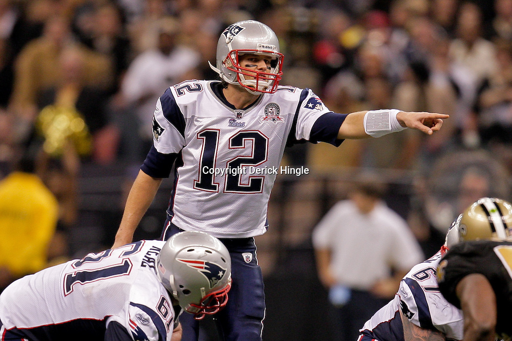 2009 November 30: New England Patriots quarterback Tom Brady (12) signals at the line during a 38-17 win by the New Orleans Saints over the New England Patriots at the Louisiana Superdome in New Orleans, Louisiana.