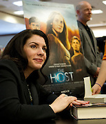 "Stephenie Meyer, author of ""The Host"" and the Twilight series, signs books at the Barnes & Noble on Northwest Highway in Dallas on Tuesday, March 12, 2013. (Cooper Neill/The Dallas Morning News)"
