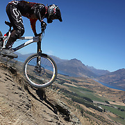 Matthew Walker from Kawerau in action during the New Zealand South Island Downhill Cup Mountain Bike series held on The Remarkables face with a stunning backdrop of the Wakatipu Basin. 150 riders took part in the two day event. Queenstown, Otago, New Zealand. 9th January 2012. Photo Tim Clayton
